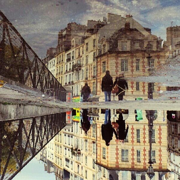Париж, улица после дождя. Мобильная фотография Натали Жеффруа